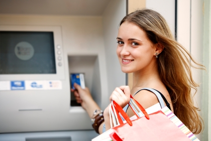 young woman withdrawing money from credit card with atm - Prepaid Credit Card For Teenager